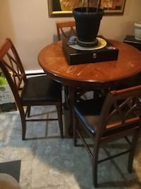 round brown wooden table with four chairs dining s Hamilton, L8K 4J6