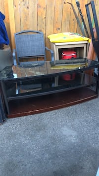 TV Stand  2 months old. 2 Glass Shelfs 1 Wood Shelf  Edmonton, T5Y