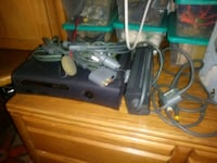 black Xbox 360 console with controllers and game cases 1629 mi