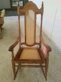 brown wooden rattan rocking armchair. Clovis, 93612