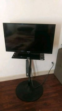 black flat screen TV with remote Mesa, 85210