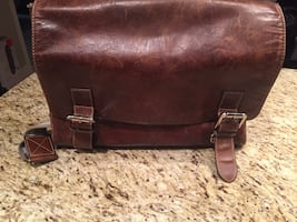 "Brown leather messenger bag - can fit up to 21"" laptop"
