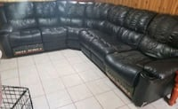 Black leather reclining sectional couch