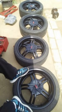 black 5-spoke vehicle wheel and tire set Alexandria