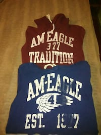two red and blue American Eagle pullover hoodies