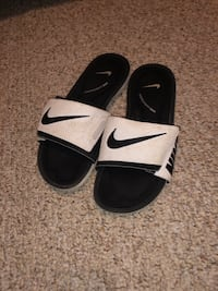 Pair of black-and-white nike slides College Station, 77845