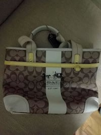 brown and white Coach tote bag New York, 10029