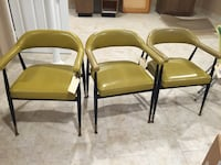Three steel framed brown leather padded armchairs Grosse Pointe