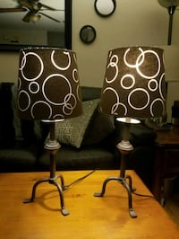 two brown metal base table lamps
