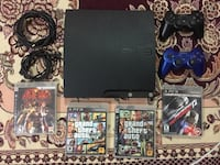 Sony PS3 slim console with controller and game cases Montréal, H3S 1H3