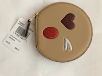 Brown hat zip Coach coin case Coquitlam