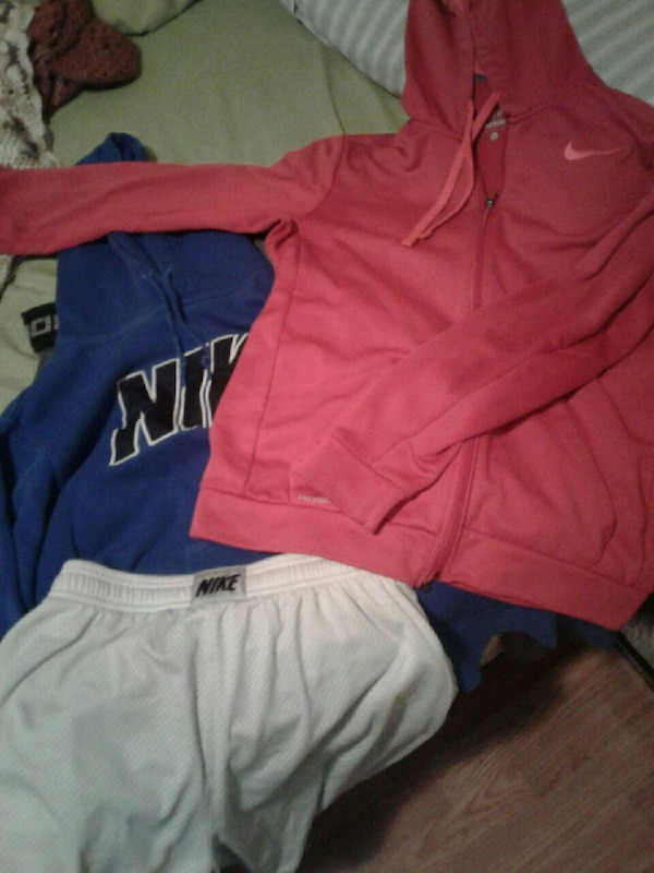 pile of Nike clothes all sizes