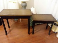 two rectangular black-and-brown wooden center tabl