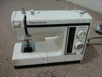 white and black Singer electric sewing machine Surrey, V3T 3G4