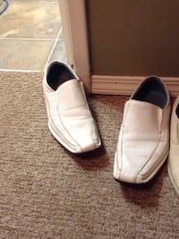 pair of white leather loafers Calgary, T2J 1V2