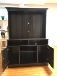 black wooden TV hutch with flat screen television Vancouver, V6S