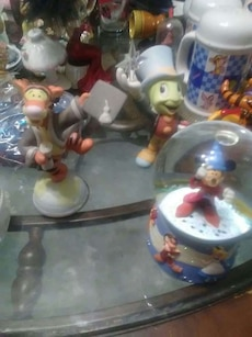 assorted animal figurine and water globe