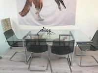Rectangular clear glass top table with four chairs dining set