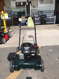 Green and black push mower Alexandria, 22306