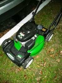 green and black push mower 932 mi