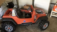 Brown and black wrangler ride-on toy