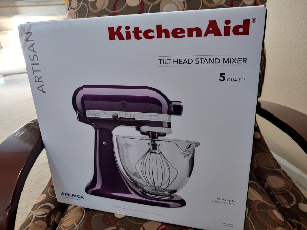 Kitchen aid artisan mixer plumberry color never opened usual price is  around 400$