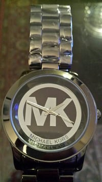 round silver Michael Kors analog watch with link bracelet