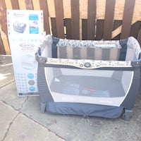 Baby's gray and white travel cot Edmonton, T5X 6B7