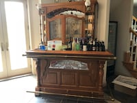 The front bar part has been sold. We still have the back lower cabinet and the upper cabinet with the mirrors. The bar stools went with the bar. Bar with rear cabinet. Liquor and wine storage. Lights, mirrors and 2 chairs. 47 km