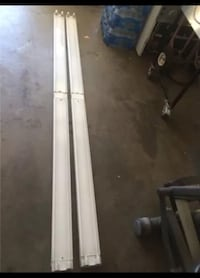 2 shop lights in good working condition no light bulbs included