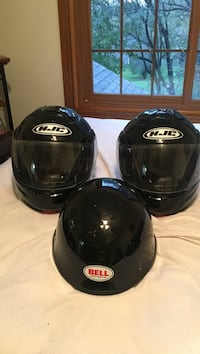 two black HJC full face helmet and Bell half face helmets, M, L, & XL, with bags, $30 each, in great condition.