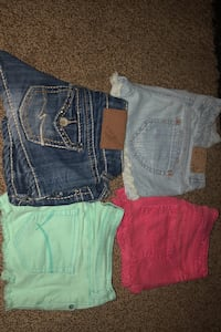 Four pair of jean shorts