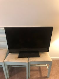 black flat screen TV with remote Mount Pleasant, 29464