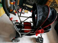 baby's black and red stroller 621 km