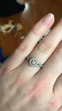 Diamond encrusted silver-colored engagement ring