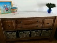 brown wooden sideboard with two white ceramic vases Denver, 80206