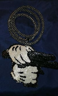 two white and black knitted textiles 911 mi