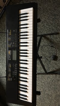 Casio blk electronic keyboard with stand and earphones