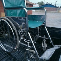 silver and teal wheelchair