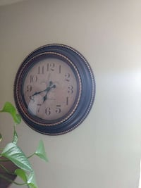round brown mirror and matching clock Welland, L3C