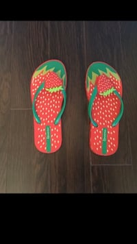 Girls size 2-3 strawberry flip flops (used once)