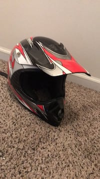 Black, white, and red motocross helmet
