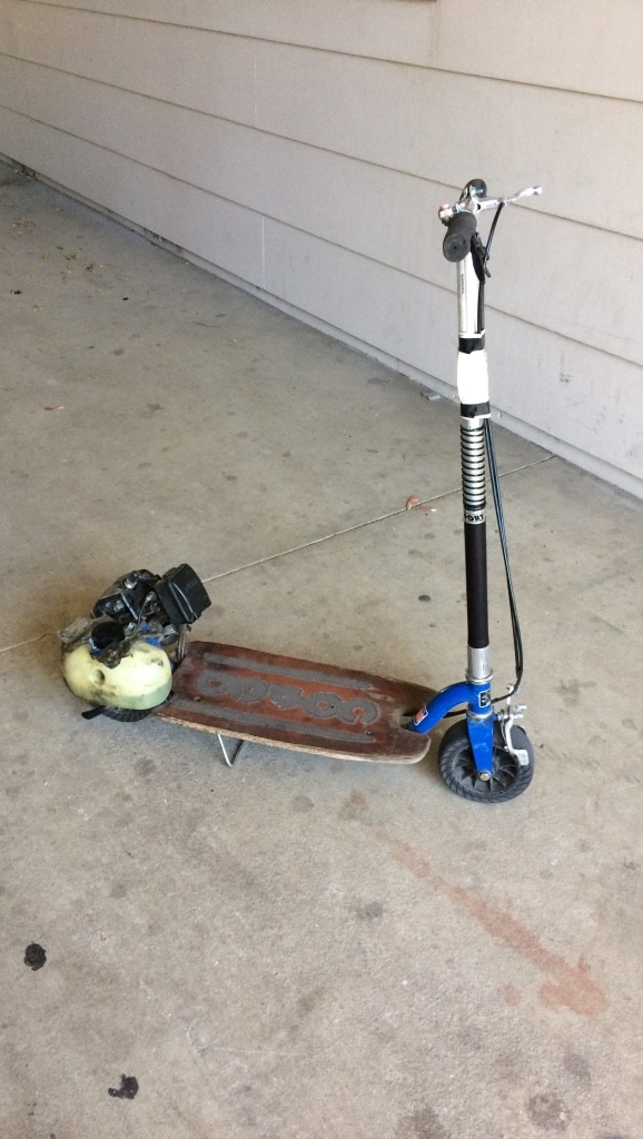 Black and white motorized scooter
