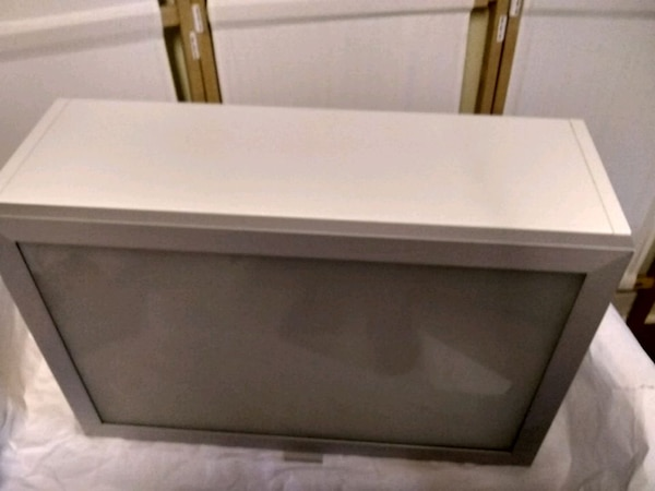 Brand new IKEA wall cabinet with glass door 03006fdf-7bde-46ae-8e97-c02713d2dd53