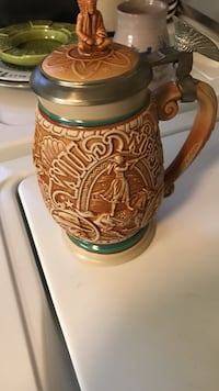 brown and beige beer stein 66 km