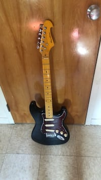black and brown electric guitar Durham, 27704