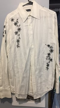 white and black floral long-sleeved dress shirt