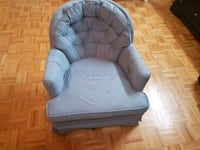 gray tufted padded sofa chair