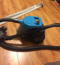 Blue and black canister vacuum cleaner and curtain rod Halifax, B3H 2Z8