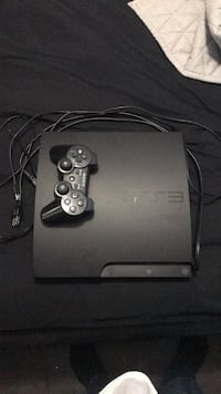 Black sony ps3 slim console with controller Guelph, N1E 6Z9